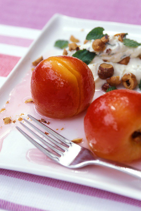 White Poached Nectarines with Sweetened Mint Cream and Toasted Hazelnuts