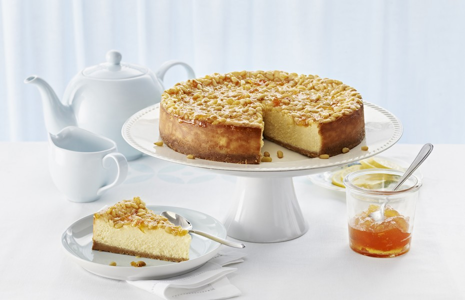 White Chocolate Bistro Cheesecake with Pine Nuts and Apricot Glaze