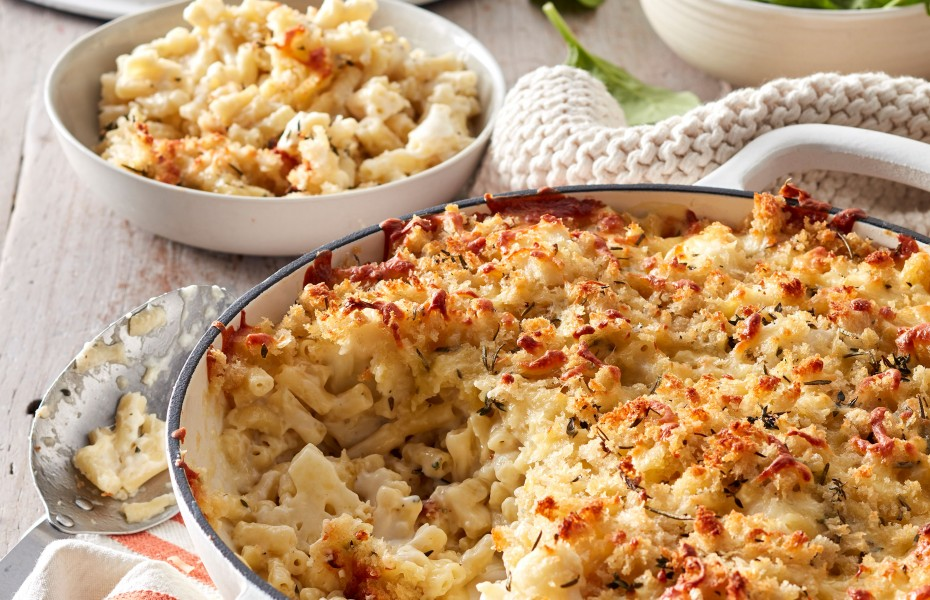 Make this tasty cauliflower mac and cheese your go to weeknight dinner recipe. Cheesy baked pasta recipes make popular family dinners, especially like this easy baked mac and cheese.