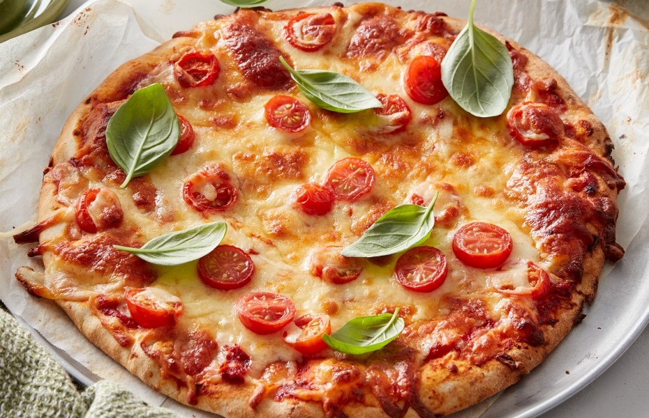 Margherita Pizza has to be one of the all time favourite pizza toppings. If you're looking for an easy pizza recipe, or what to know how to make the best pizza, try this pizza recipe.
