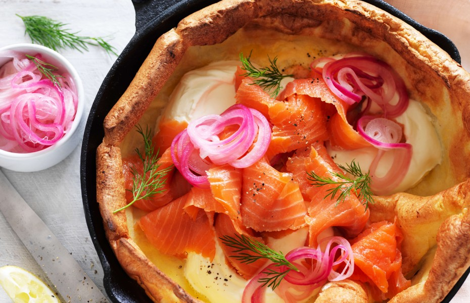 Smoked salmon Dutch Baby recipe with cream and pickled onion