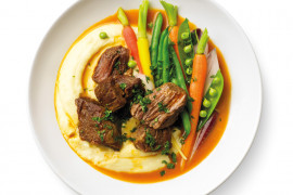 Juicy and tender beef with mash and cooked vegetables