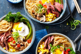 beef ramen noodles with eggs in bowls