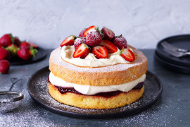 Fluffy sponge cake with jam, cream and berries