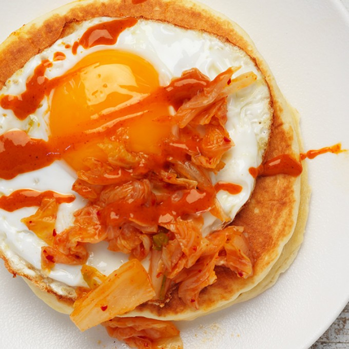 Easy pancake recipe with fried egg, kimchi and chilli sauce