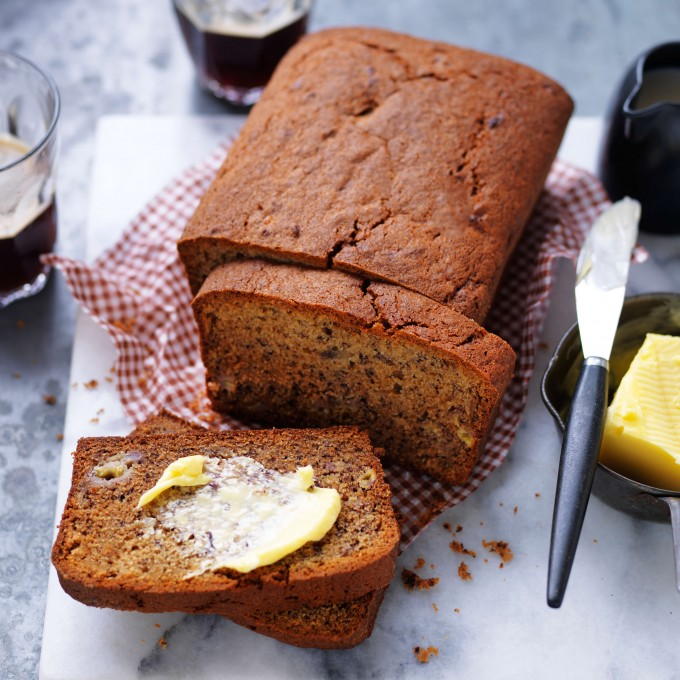 Classic banana bread recipe sliced with butter