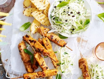Satay and coconut chicken breast skewers with green apple coleslaw and BBQ kindler potatoes