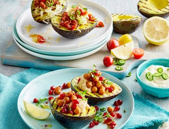 Grilled Avocado with salsa taco filling and harissa hummus