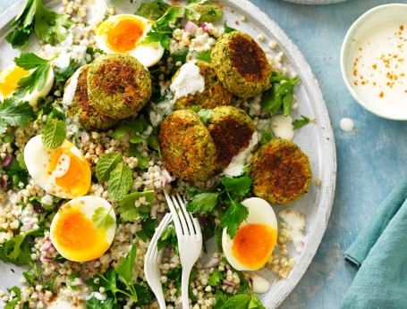 Baked falafel on plate with salad and eggs