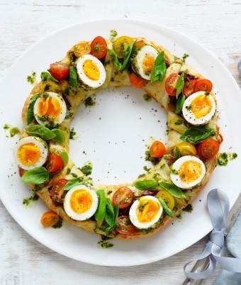 Christmas pastry wreath with pesto eggs