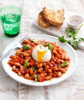 For a brunch recipe that will satisfy, try this homemade baked beans recipe. These smoky baked beans are served with a perfectly poached egg on top.