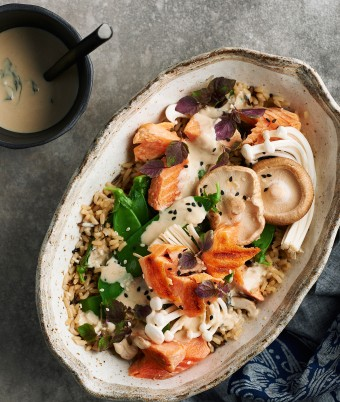 Healthy brown rice bowl with ocean trout and mushrooms
