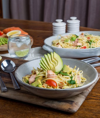 This is a photo of trout and avocado pasta