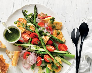 Simply stunning summer asparagus salad recipe with herbs and halloumi, just right for your next barbecue. You'll want to use the green herb dressing on other salad recipes too.