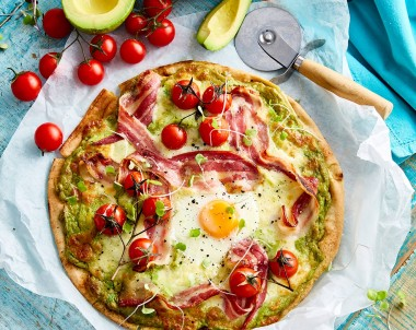 Breakfast pizza with egg and avocado
