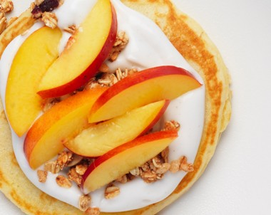 Easy pancake recipe with healthy topping idea of coconut yoghurt, granola and nectarine