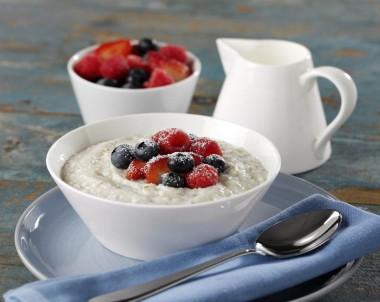 Creamy Porridge With Strawberries, Blueberries And Raspberries
