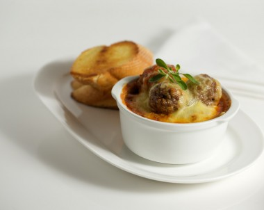 Herbed Pork Meatballs with Cheesy Topping