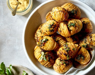 Roasted hasselback potatoes with herb butter