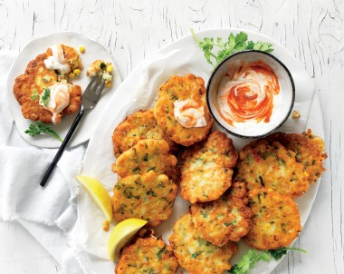 Make these fresh corn fritters with prawns for a light lunch or as an easy appetiser. Corn fritters are perfect for finger food when served with a sriracha yoghurt.
