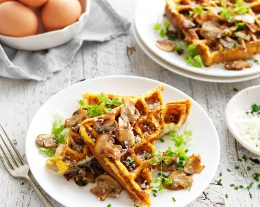 Low carb waffle with mushrooms and fresh herbs and eggs