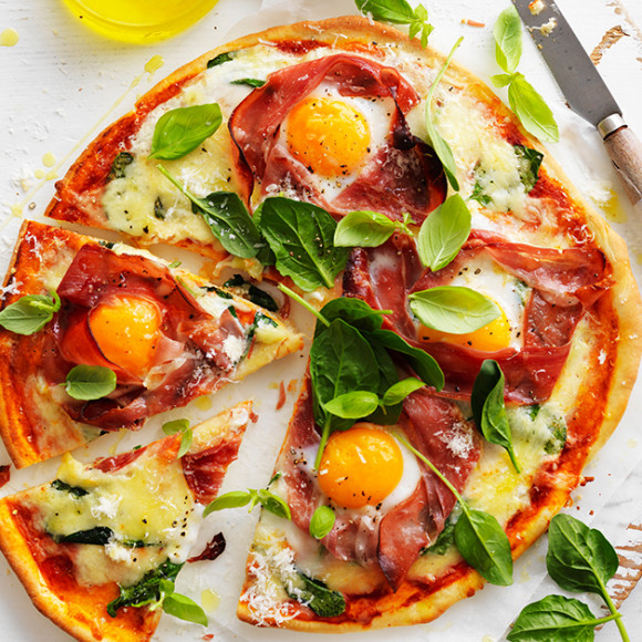 Delicious breakfast pizza with prosciutto and Egg at Easter