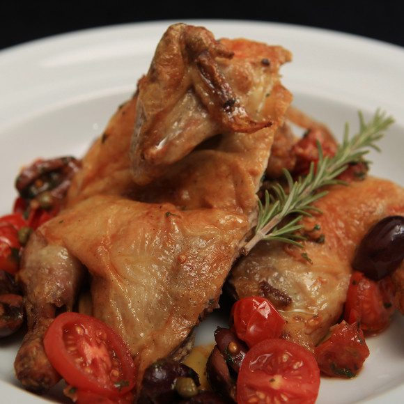 Butterflied Spatchcock with Tomato, Olive and Caper Sauce