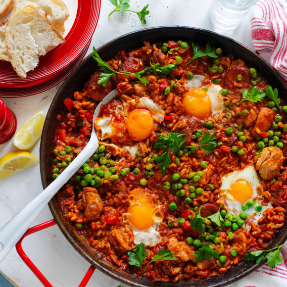 Baked chicken and chorizo paella with eggs