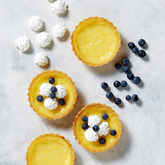 Classic Lemon Tarts with Meringue Buds and Blueberries