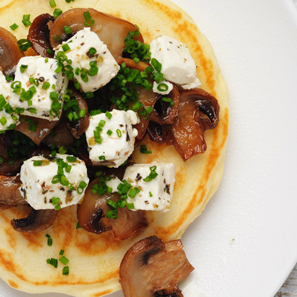 Healthy savoury pancake recipe topped with garlic mushrooms and fetta