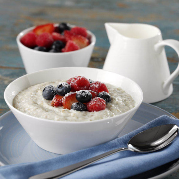 Creamy Porridge With Strawberries, Blueberries And Raspberries