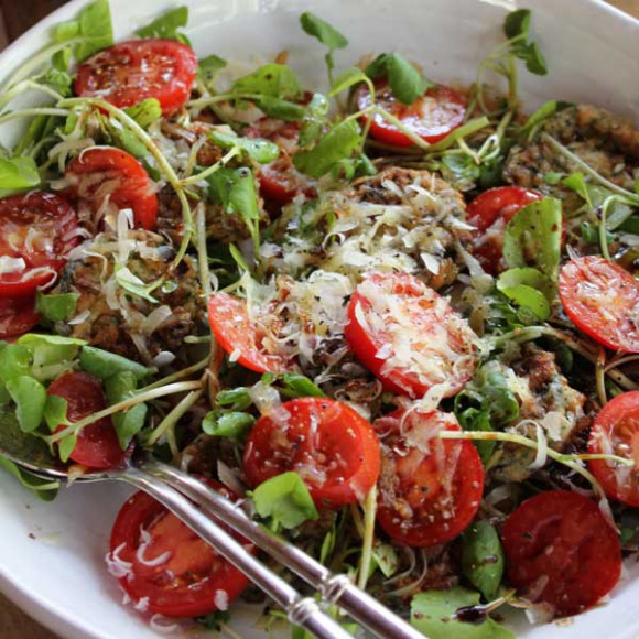 Parmesan fried eggplant salad with tomatoes and watercress