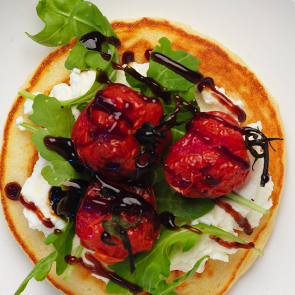 Easy fluffy pancake with ricotta, rocket and roast tomato topping