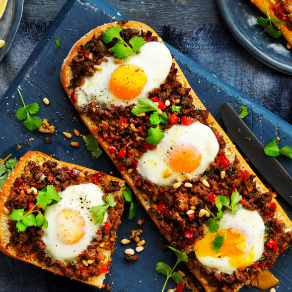 Turkish bread with spiced lamb and eggs