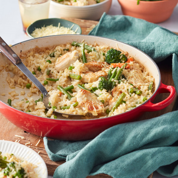 Make this easy oven-baked chicken and rice recipe for dinner tonight. It's a no-stir risotto with chicken and no-prep frozen vegetables. This one-pan recipe means less mess and fuss.