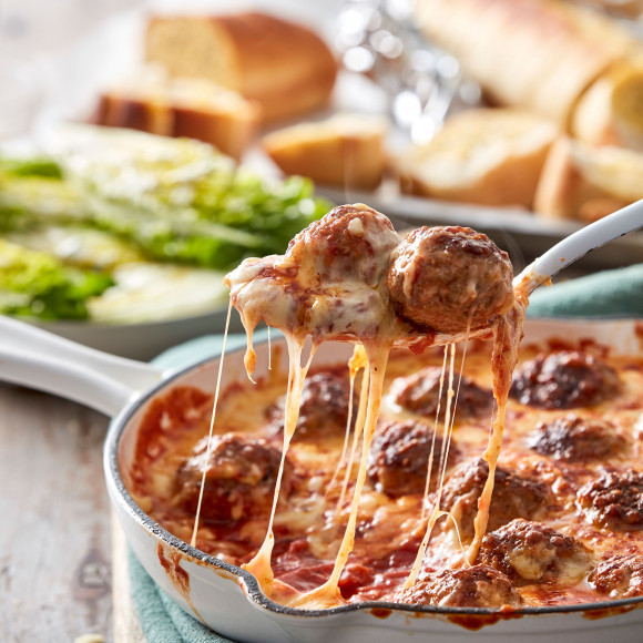 This Meatball Parmigiana is a one-pan recipe and includes a how to make meatballs recipe. Perfect family dinner recipe.