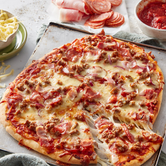 This Italian meat lovers pizza recipe is the perfect pizza recipe for people who love meat pizza toppings. This homemade pizza recipe includes how to make a basic pizza dough.