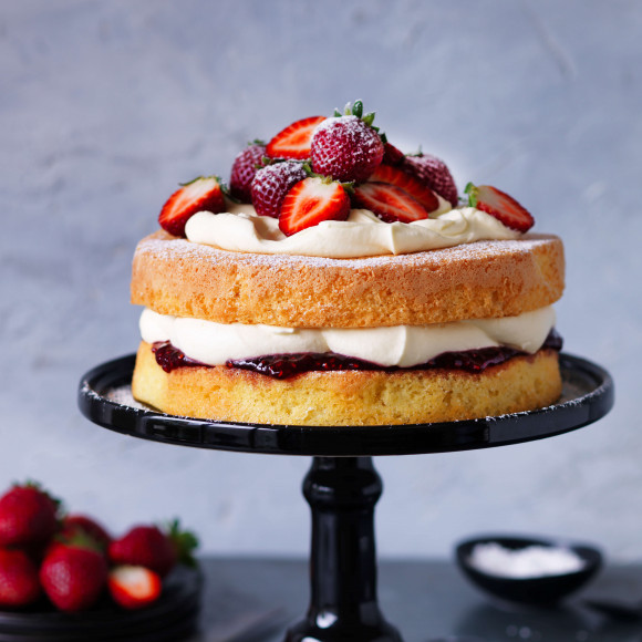 Traditional sponge cake with jam and cream