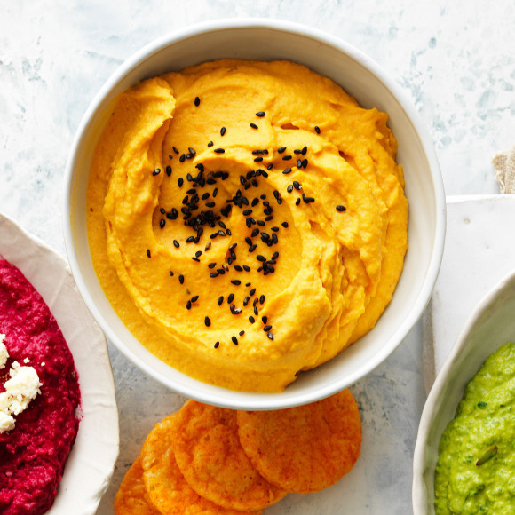 This stunning sweet potato and turmeric hummus is a delicious snack or appetiser recipe.