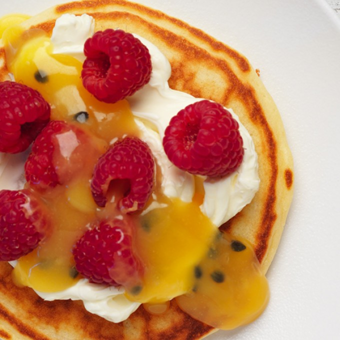 Delicious pancake recipe with mascarpone, passionfruit curd and raspberries